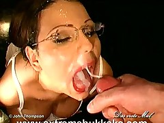 Chick with glasses drinking jizz