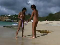 Naked teens fool around on public beach (just-drew)