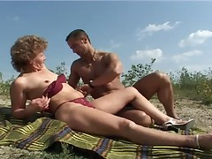 Mature with small tits big nipples gets fuck on beach
