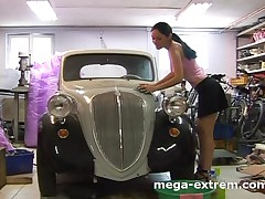 Hot wife is washing her husbands car