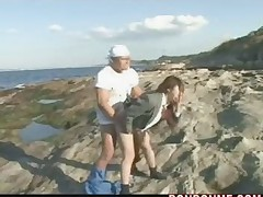 Girl played with friend but fucked by workman on the beach
