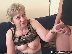Nasty granny plays with her pussy then takes two cocks