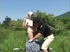 Hairy granny in a headscarf - outdoors