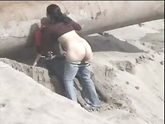 Latino couple caught on the beach