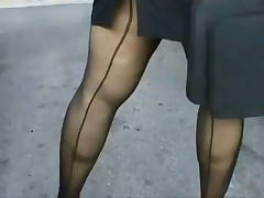 Busty mature, heels, seamed stockings and upskirt