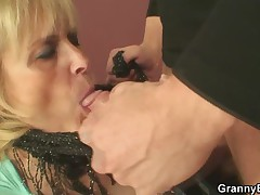 Blonde grandma gets fucked on the table