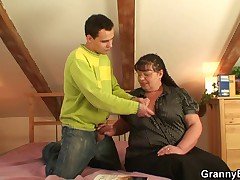Big titted mature lady is banged by an young guy