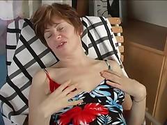 Granny masturbating with black toy