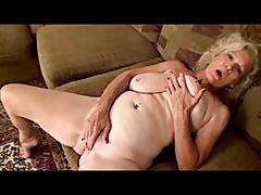 Granny with nice tits masturbates her hole