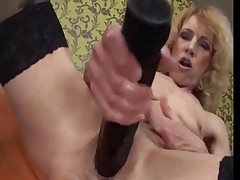 Granny Masturbates then gets Fisted by a Hot Brunette