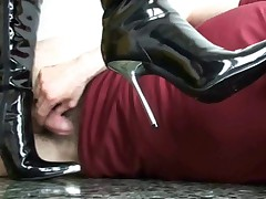 Licking cum from boots of mistress