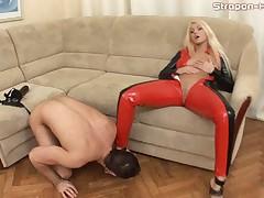Latex mistress fucks slave