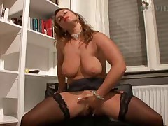 German woman fucks herself in stockings and boots