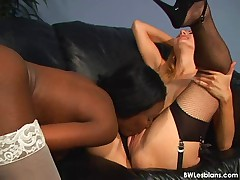 Black and white lesbian sex on a leather couch