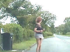 Zoe's micro-skirt lifted by the wind to expose her cock