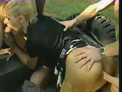 Two italian police officers fucking a prisoner in outdoor