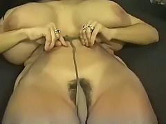 Muff of a whore is stretched wide by dildos