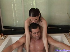 Busty babe sucks on a huge cock in the jacuzzi