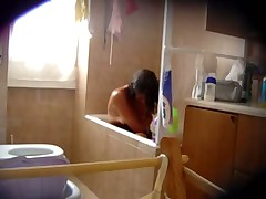 Hairy girl in bath - hidden cam