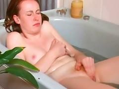 Redhead solo orgasms in bath