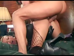 Two blondes in latex and stockings share a cock