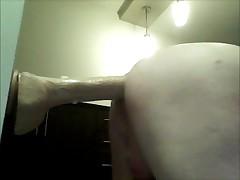 Riding big thick long dildo