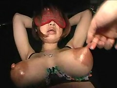 Lactating Asian gets her tits worked over