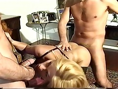 Young blonde shemale rammed by two sticks