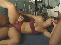 Sexy instructor fucked by two guys at the gym
