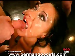 Busty brunette babe gets covered in jizz