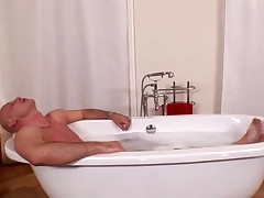 Busty Dominno gets fucked in bathroom