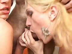 Two flat chested Tgirls work with one dick