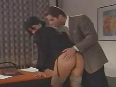 A Italian Secretary works hard in the Office