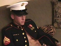 Marine cleaning his rifle