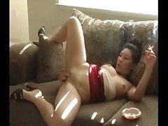 Asian girl smoking and masturbating
