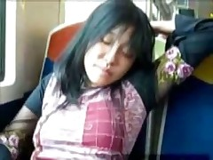 Asian girl fingers herself on unseat train