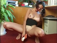 Ally with pigtails masturbates in her office