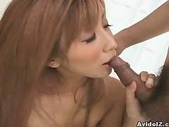 Two cute Japanese babes fucked in group sex
