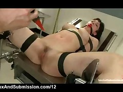 Strapped Babe Fucked And Shocked In Gynecological Table