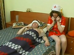 Mature Nurse At Patient House
