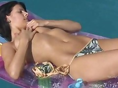 Bikini Teen Rubs Her Shaved Pussy In The Pool