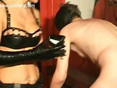 Hot Mistress Spanks Slave On His Ass With A Wooden Stick..
