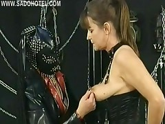 Masked Mistress Wearing Leather Mask Plays With Tits Of..