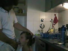 Couple Having Sex In Kitchen