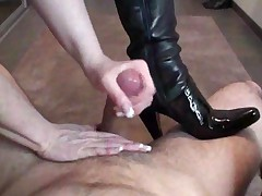 Girl In Leather Boots Gives Good Handjob