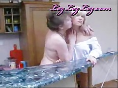 Milf And Teen Having Hot Lesbian Sex In The Kitchen