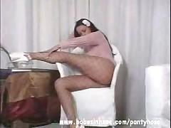 Stunning Babe Stripteasing In Fishnet Pantyhose