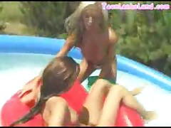Teen Lesbians Play In Pool