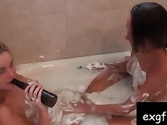 Two Hotties Shaving In The Tub