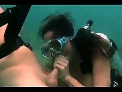 Scuba diving couple has underwater sex